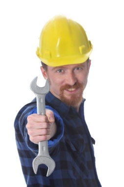 Construction worker holding a wrench