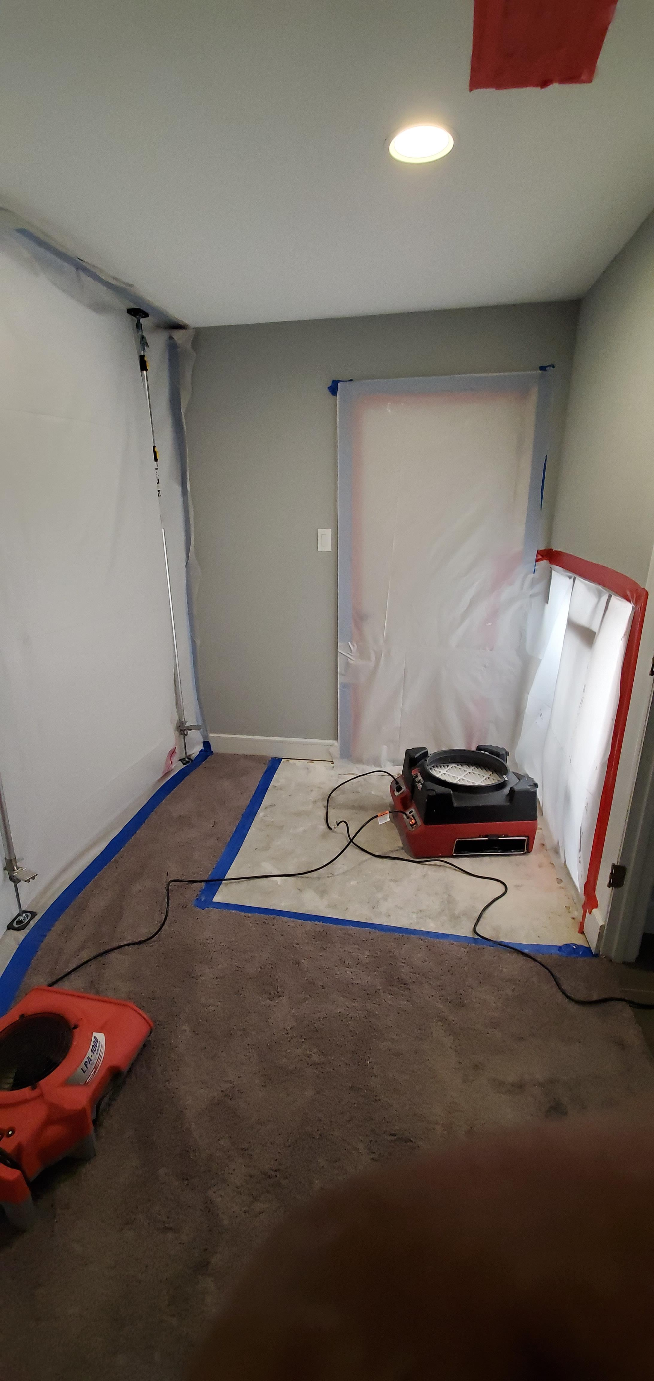 Room covered in protective wrap