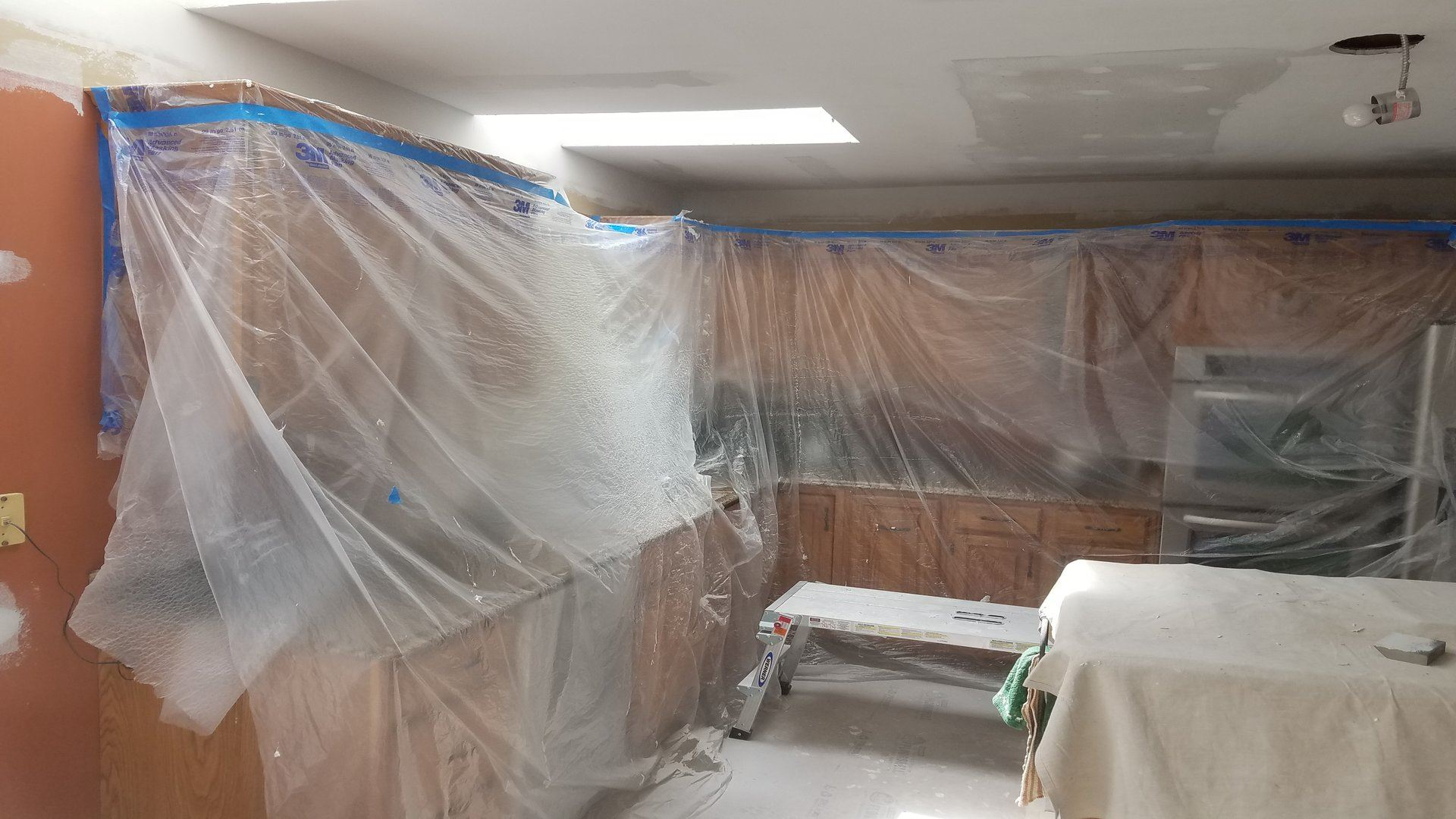 Cabinets covered in protective covering